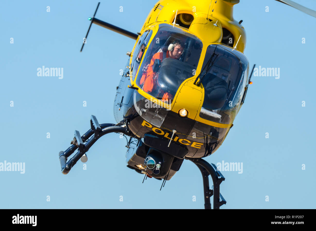 police-helicopter-with-pilot-eurocopter-ec135-helicopter-law-enforcement-aviation-flying-with-space-for-copy-R1P207.jpg