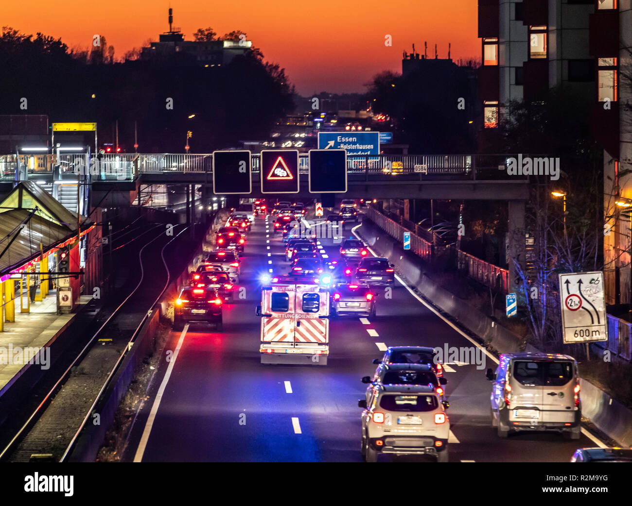 Ambulance drives with blue lights and sirens, on a highway, A40 in Essen, to an emergency mission, rescue lane, Germany - Stock Image