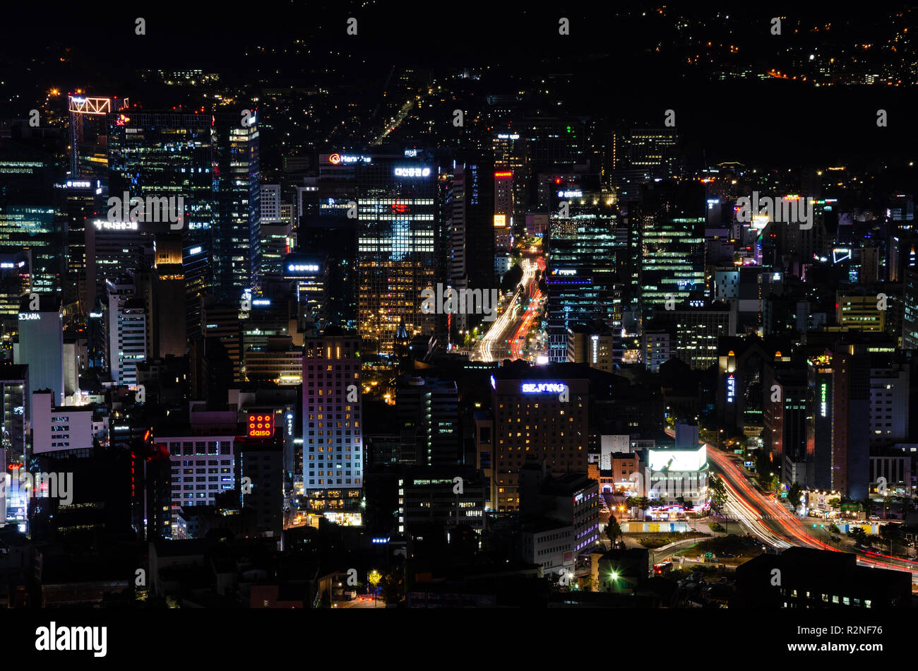 a-view-of-the-city-of-seoul-below-at-night-lit-up-with-city-lights-taken-form-a-high-vantage-point-next-to-namsan-tower-seoul-south-korea-R2NF76.jpg