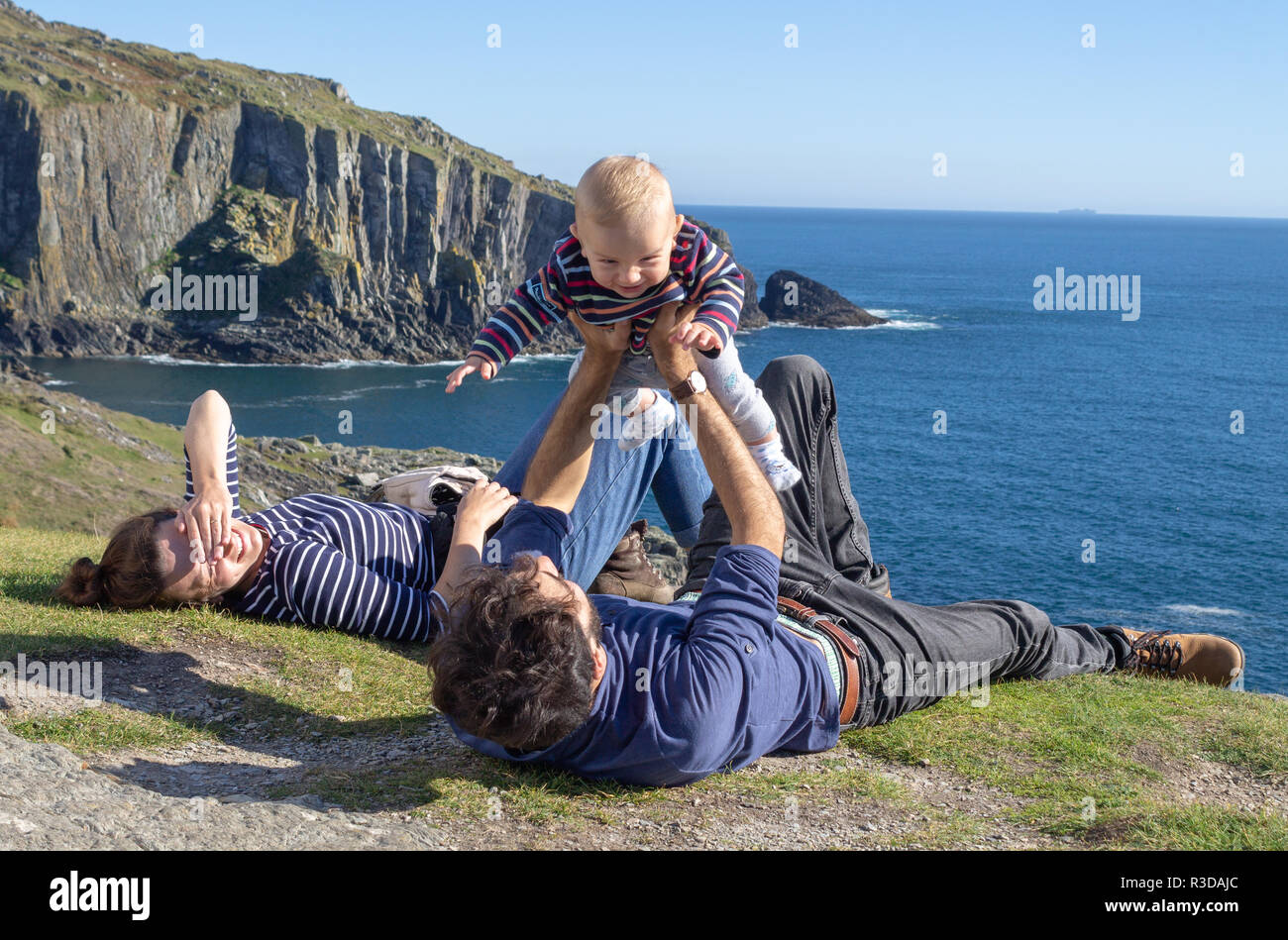 family-on-summer-holiday-with-small-child-on-a-cliff-top-or-clifftop-baltimore-west-cork-ireland-R3DAJC.jpg