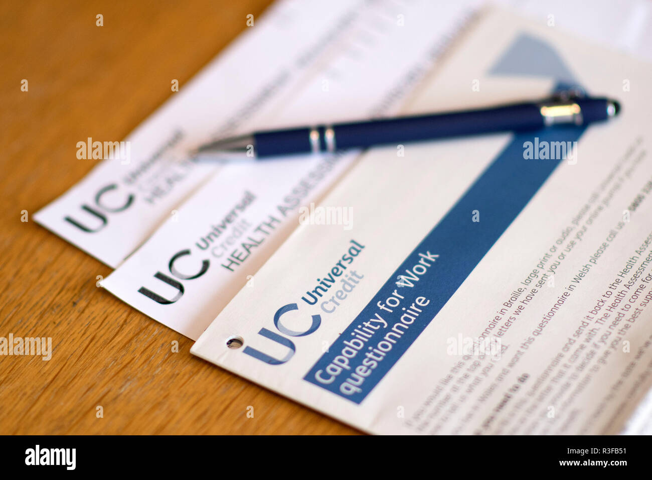 A picture shows a Universal Credit Capability for Work questionnaire form being filled out by a person off work with long term illness. UK. Nov 18.Stock Photo