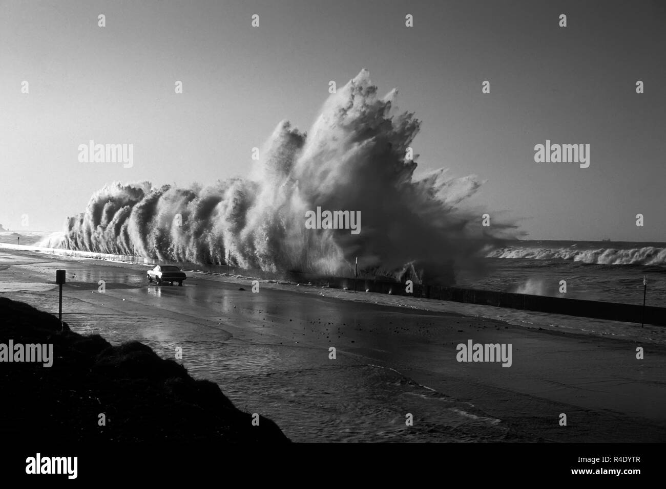 Huge storm surge wave crashes into a wall Solimar Beach.  Highway 1 California. Stock Photo