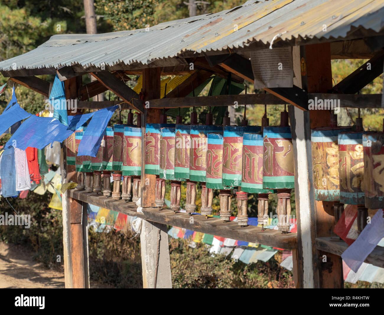 Prayer Wheels on the path to Taktsang Monastery, Bhutan Stock Photo