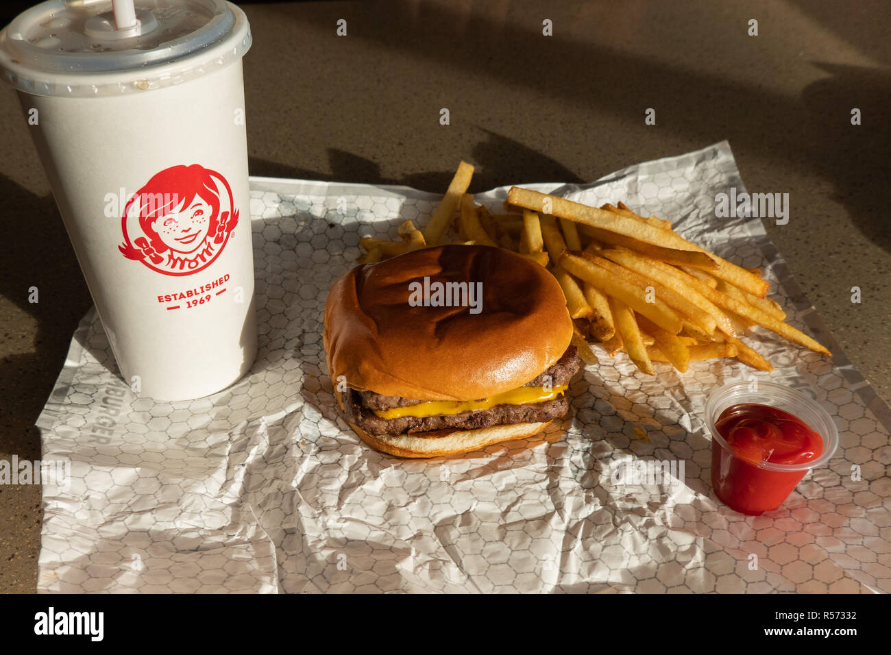 a-wendys-daves-double-cheeseburger-combo-consisting-of-a-double-cheeseburger-fries-and-a-beverage-at-their-location-in-amsterdam-ny-usa-R57332.jpg