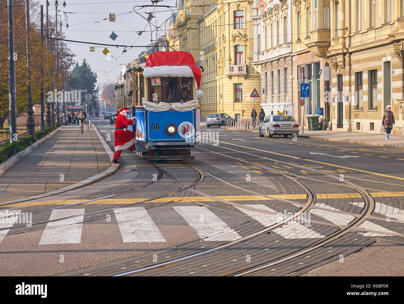 Santa boarding Santa Claus' tram, as part of the Advent Market celebration in Zagreb, going through the streets of the capital during Christmas season Stock Photo