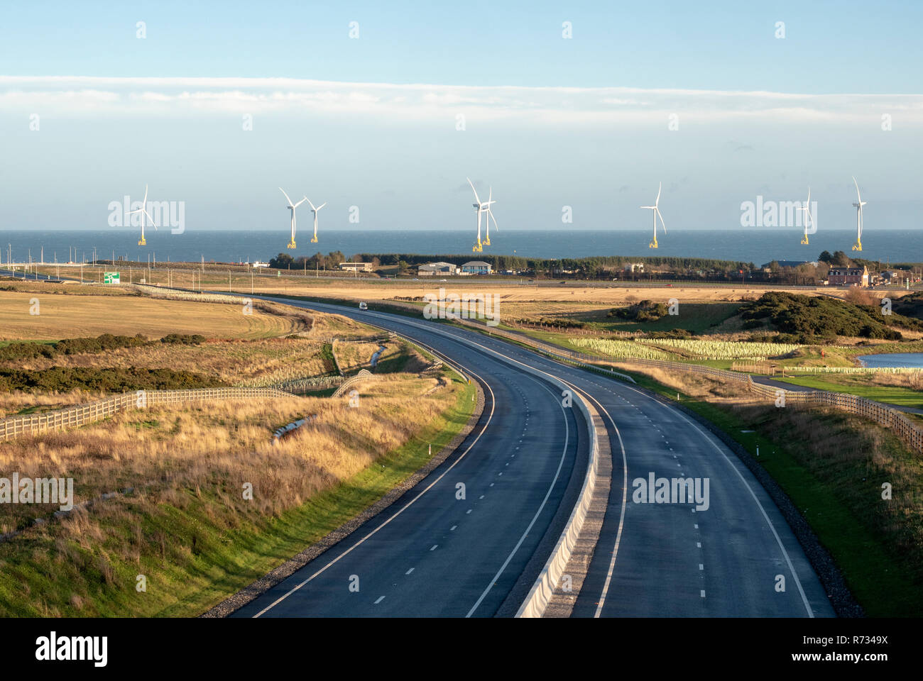 View of the new Aberdeen bypass road looking toward offshore wind farm Stock Photo