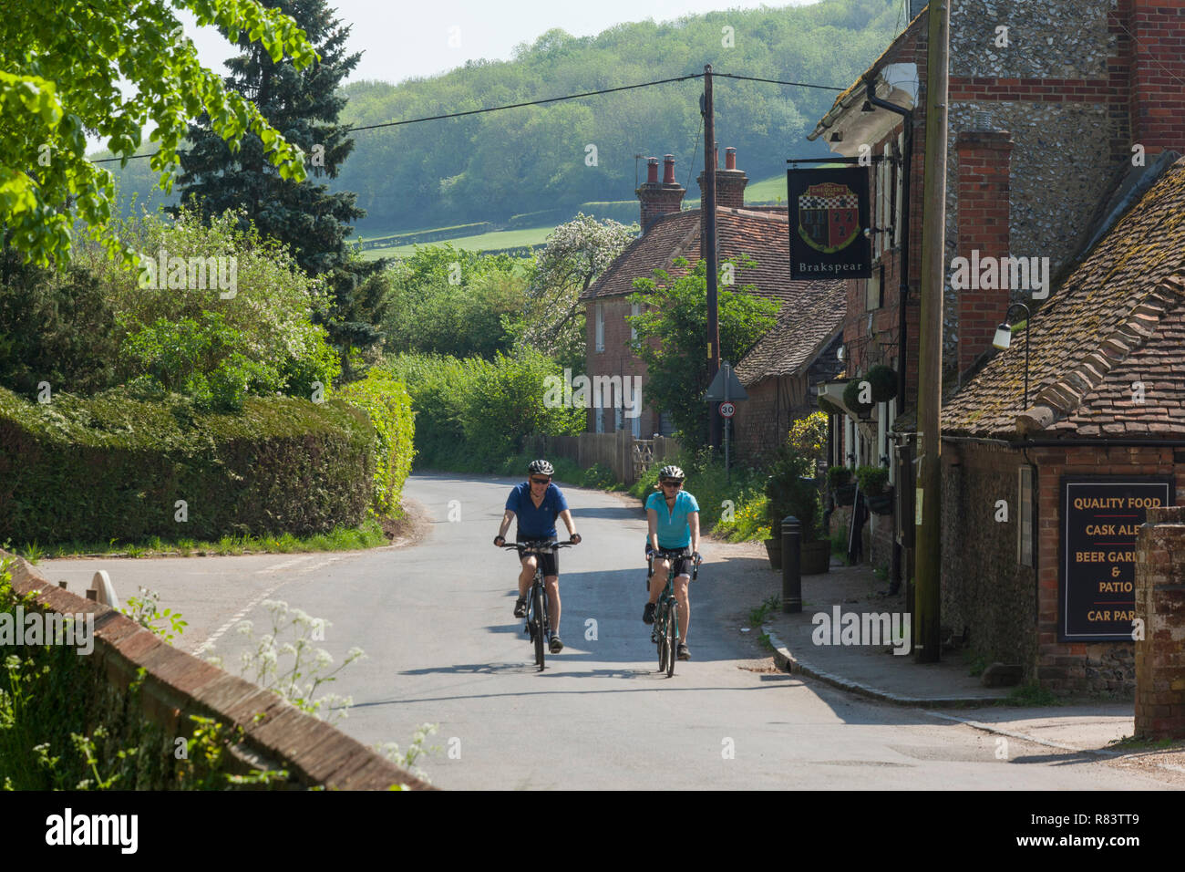 Cyclists in a country lane in the village of Fingest, Buckinghamshire Stock Photo
