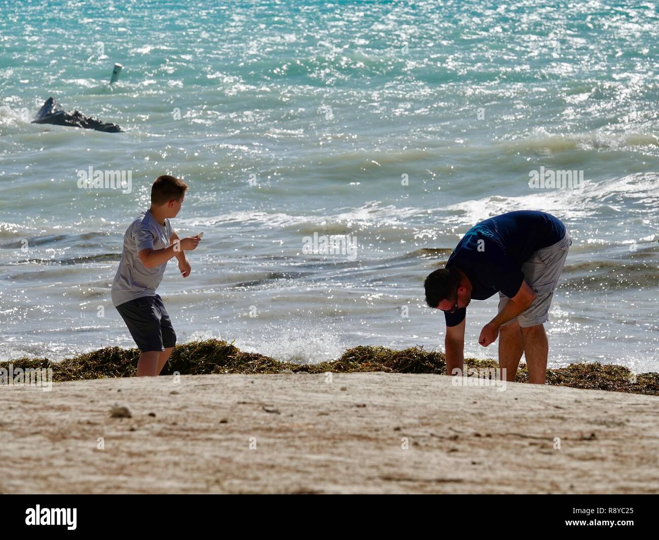 father-and-son-playing-together-on-the-b
