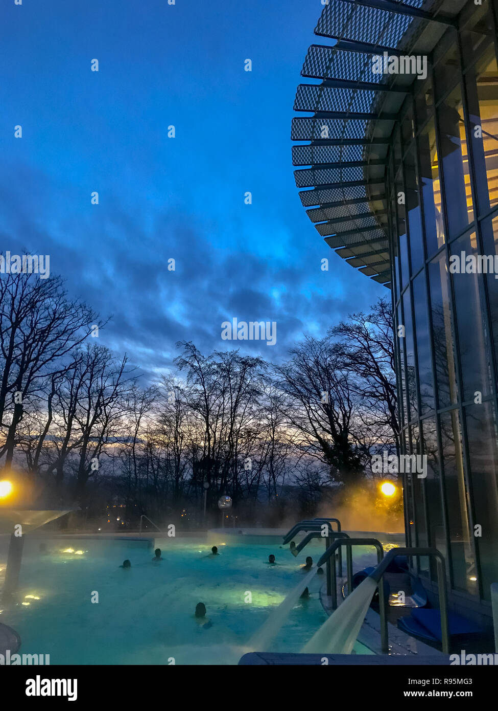 December 2018 - Spa, Belgium: Outdoor pool at the Les Thermes de Spa, the main spa complex of the town Spa, during blue hour. Stock Photo