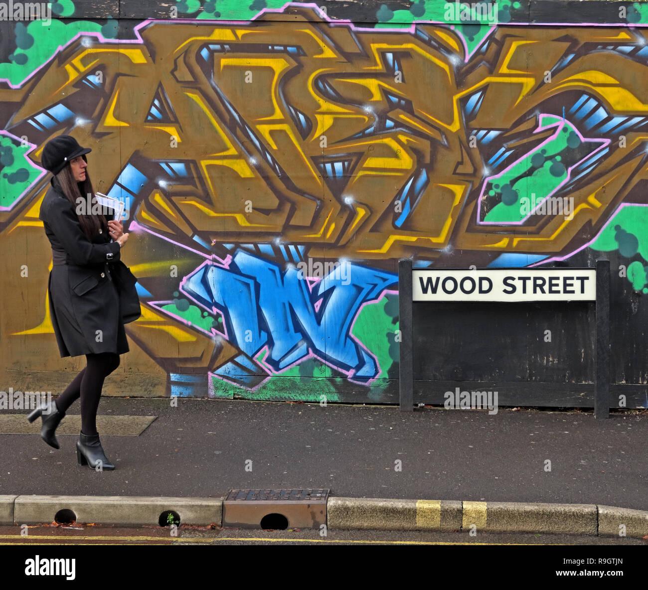 GoTonySmith,@HotpixUK,HotpixUK,Somerset,South West England,UK,Woman in black,walking past graffiti,colorful,colourful,contract,lady,walks,walking,walking past,TA1
