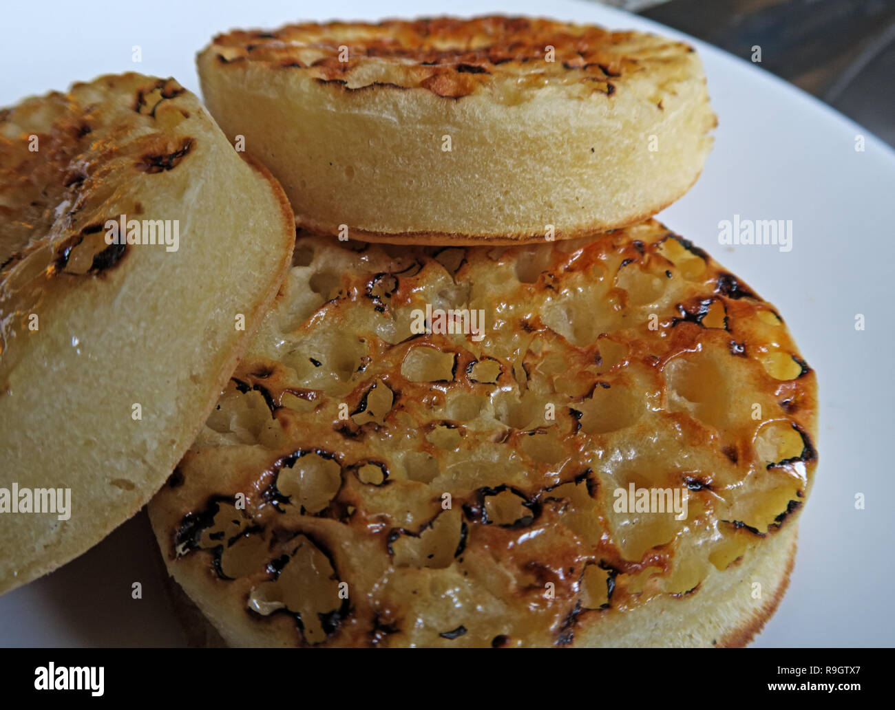 HotpixUK,@HotpixUK,GoTonySmith,buttered,toasted,sitting,hot,small griddle cake,small,griddle cake,bread,breads,picklet,picklets,breakfast,tasty,vegan,Wales,eat,food,English,shortage,warbies,Warburtons,Warburtons Crumpets,Warburtons Crumpet,grocery,groceries,midlands,circular,round,English Crumpet,English Crumpets,White Plate,England,northern England