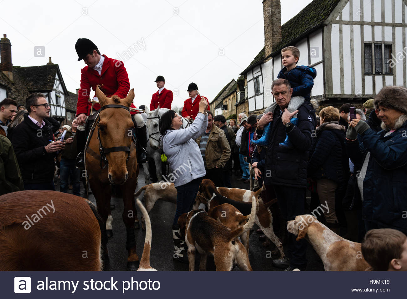 Lacock, Wiltshire, UK. 26th December, 2018. Joint masters and crowd with hounds credit Estelle Bowden/Alamy Live News Stock Photo