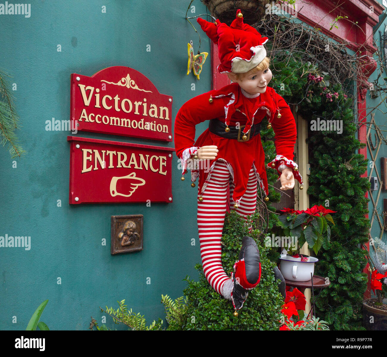 christmas-elf-decoration-on-guest-house-entrance-R9P77R.jpg