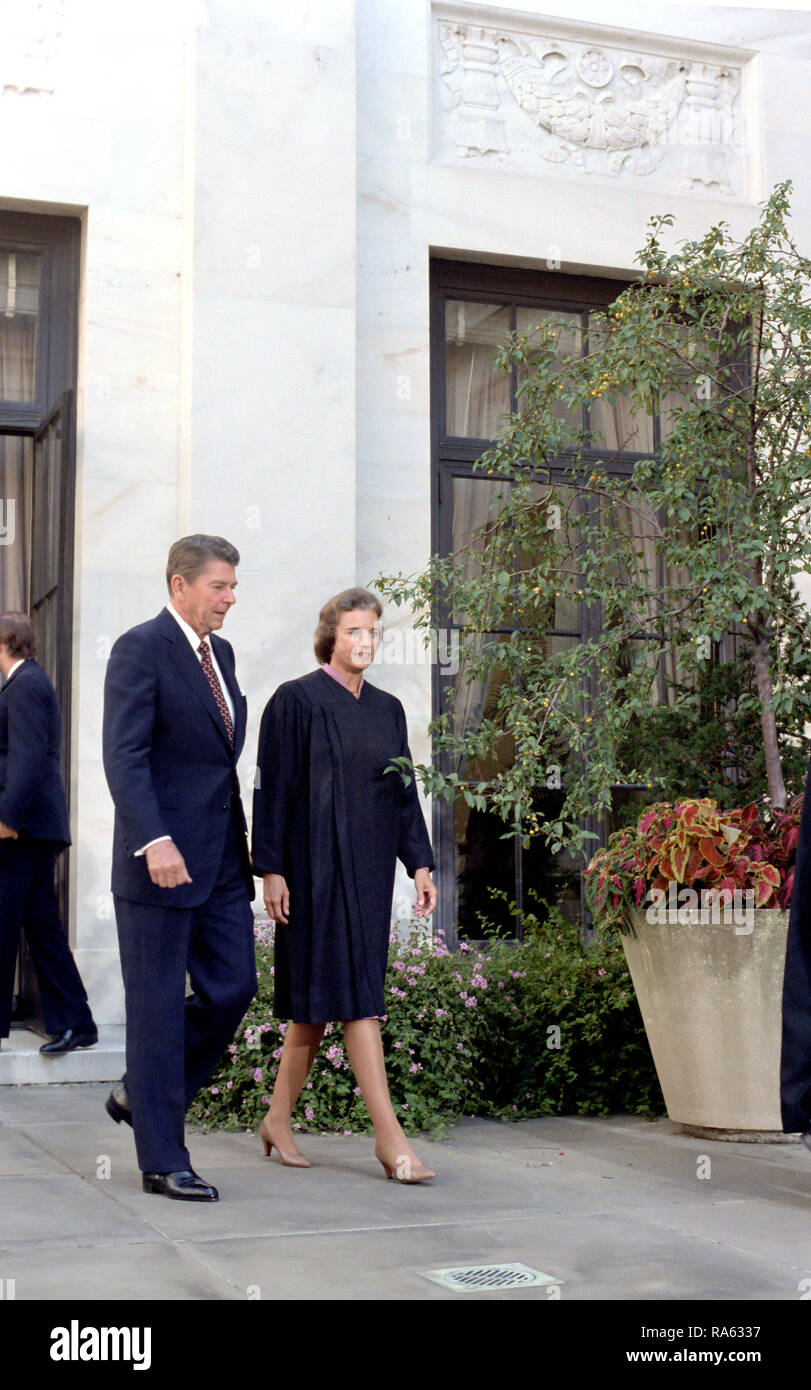 9/25/1981 President Reagan and Justice Sandra Day O'Connor outside the Supreme Court after her swearing-in ceremony Stock Photo