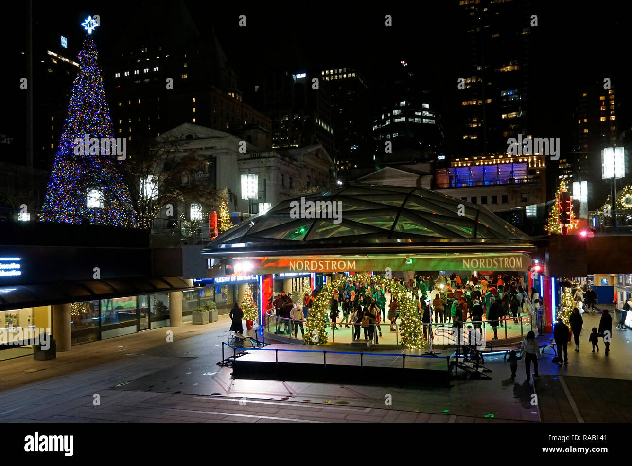 people-ice-skating-on-an-outdoor-rink-in