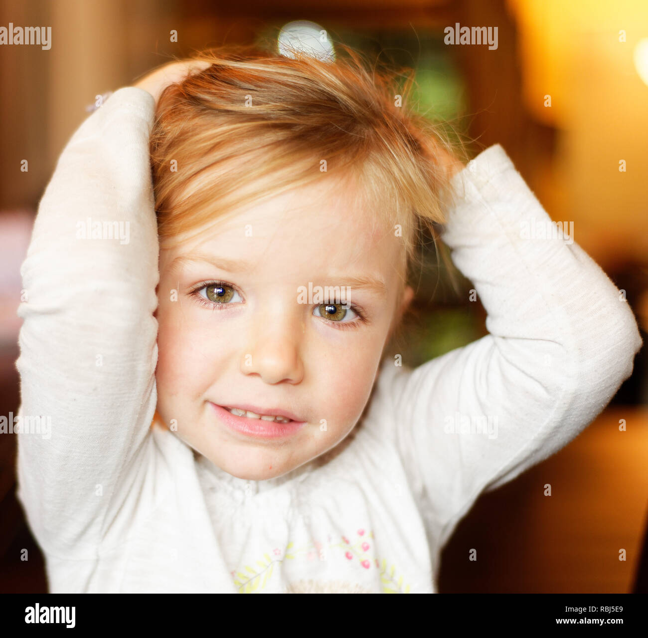 a-portrait-of-a-beautiful-smiling-four-year-old-girl-RBJ5E9.jpg