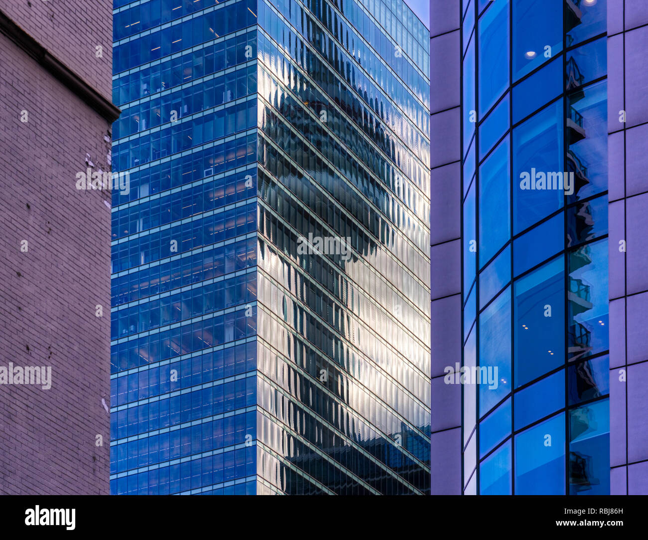 the-cn-tower-reflected-in-the-rbc-centre-aka-the-rbc-dexia-building-in-toronto-canada-as-seen-from-david-pecaut-square-RBJ86H.jpg