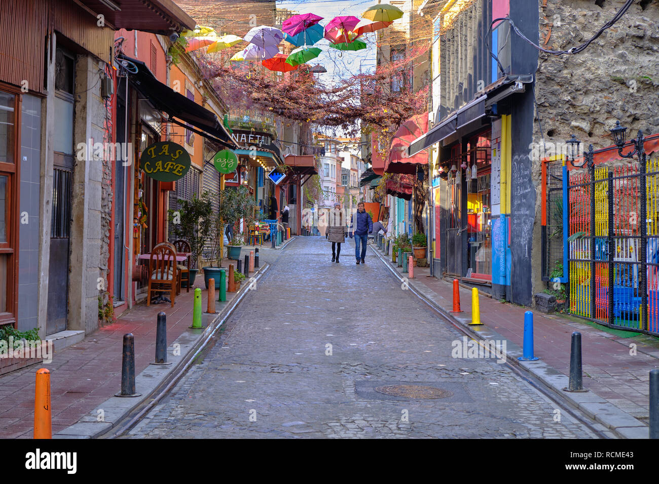pedestrian-walking-down-a-street-in-colorful-balat-area-of-istanbul-on-a-cold-december-day-RCME43.jpg