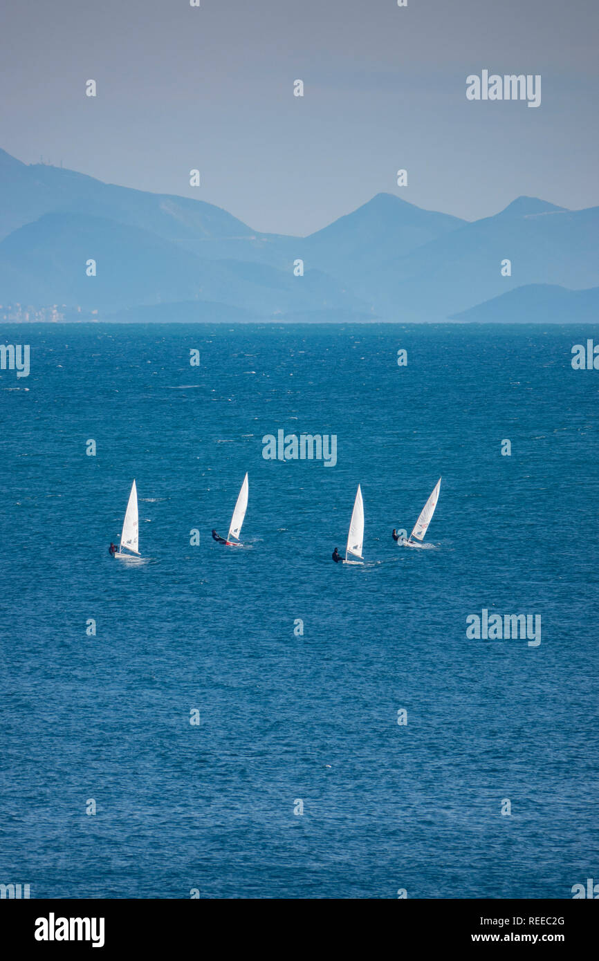 europe-greece-corfu-ionian-sea-competitive-sailing-in-single-person-sailboats-opti-j-sailboats-REEC2G.jpg