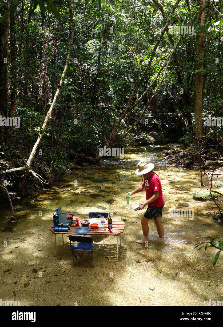 Picnic table with BBQ set up in rainforest creek, Dinden National Park, near Cairns, Queensland, Australia. No MR or PR Stock Photo