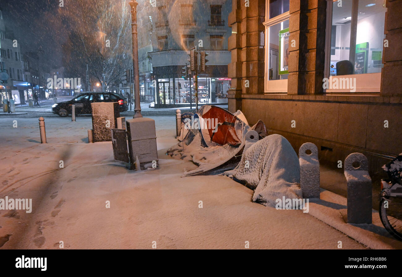 Brighton UK 31st January 2019 - Homeless tents covered in snow in central Brighton as heavy snow falls in the south tonight with more forecast throughout Britain Credit: Simon Dack/Alamy Live News Stock Photo