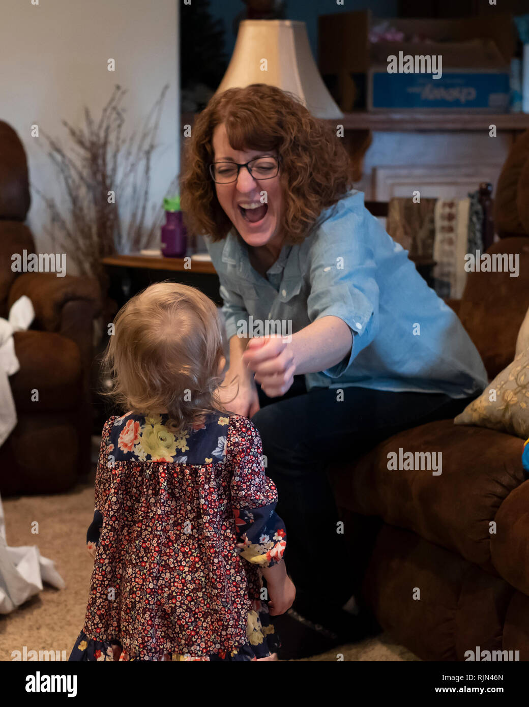 adult-caucasian-woman-laughs-and-reaches