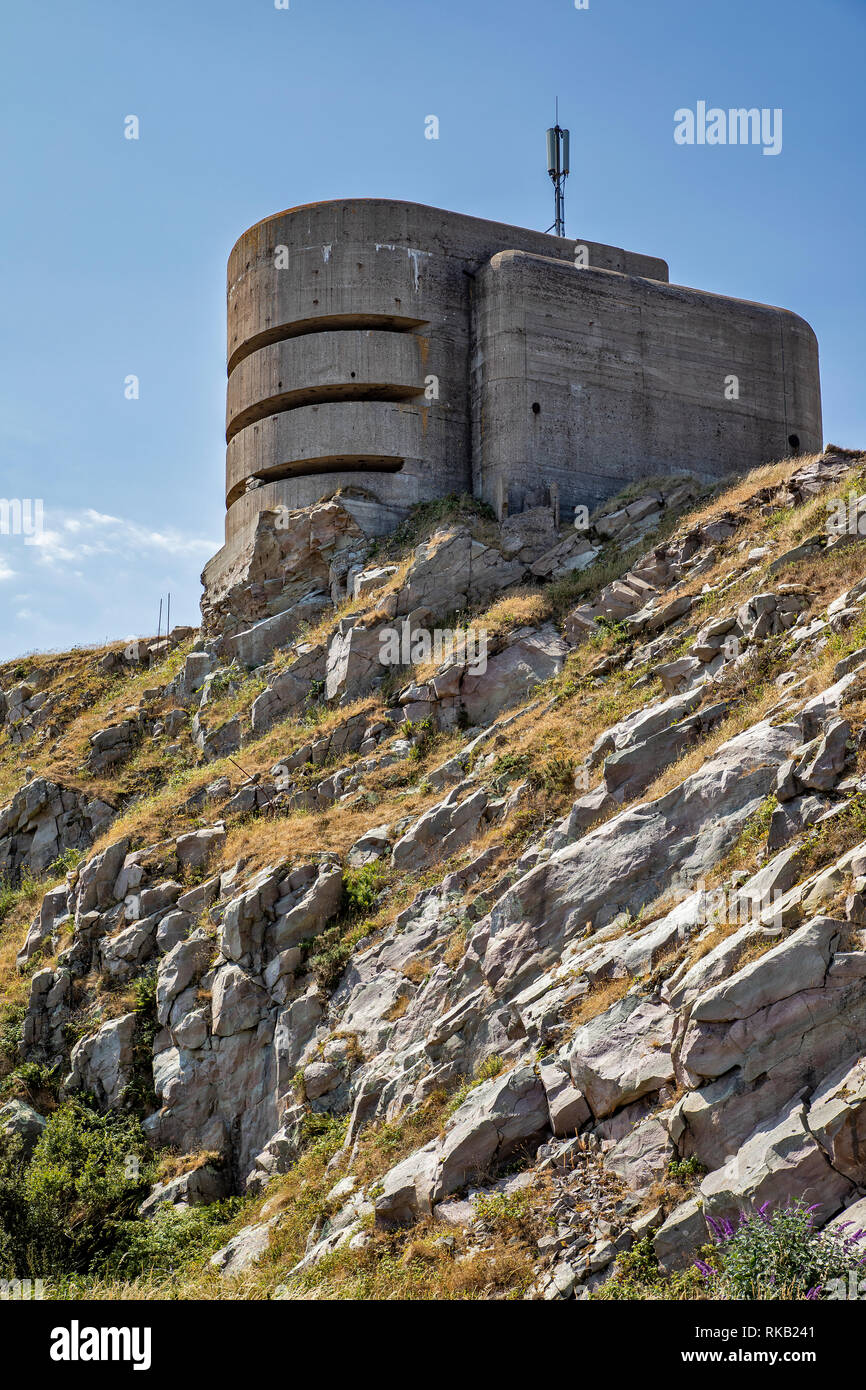 The German fire direction Post on Alderney, locally known as the Odeon, now used for siting a communications antenna. Stock Photo