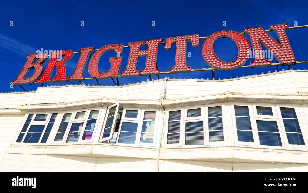 GoTonySmith,HotpixUK,@HotpixUK,South East England,England,seaside,English,UK,GB,coast,coastal,town,summer,resort,council,Sussex,tourists,travel,LGBT,LGBTQ,community,lesbian,gay,bisexual,homosexual,same sex households,Piers,British,sign,English seaside,Brighton sign,red,red Brighton sign,white pier,white,pier,pier building,windows,window,Brighton window