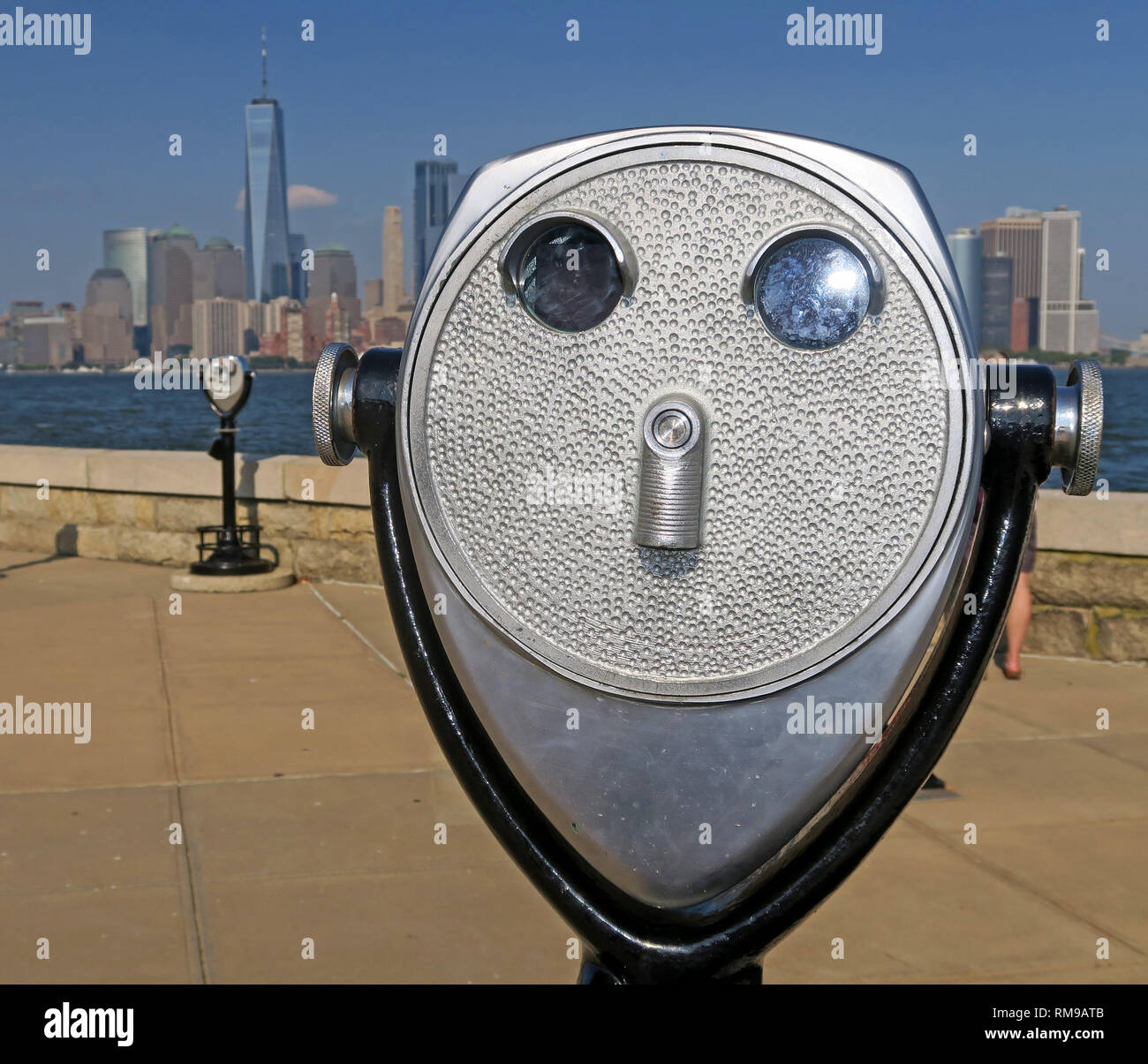 GoTonySmith,HotpixUK,@HotpixUK,Manhatten From Liberty Island,steel,binoculars,classic,vintage,coin,operated,tourist,tourism,pay,harbour,USA,lower Manhattan,United States,America,tourist binoculars,face,tower viewer,mounted on a stalk,mounted on a tower,device,telescope,scenic,lookouts,observation binoculars,observation telescope,observation viewer,revenue,spyglass viewer,spyglasses,stationary,view master,goggle guys,Tower Optical Co,SeeCoast Manufacturing Company