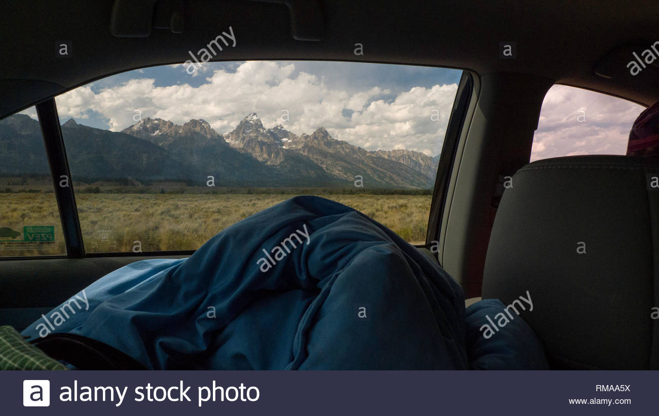 Looking out of car window at iconic view of the Grand Teton mountain peak, Grand Teton National Park, Teton County, Wyoming, USA Stock Photo