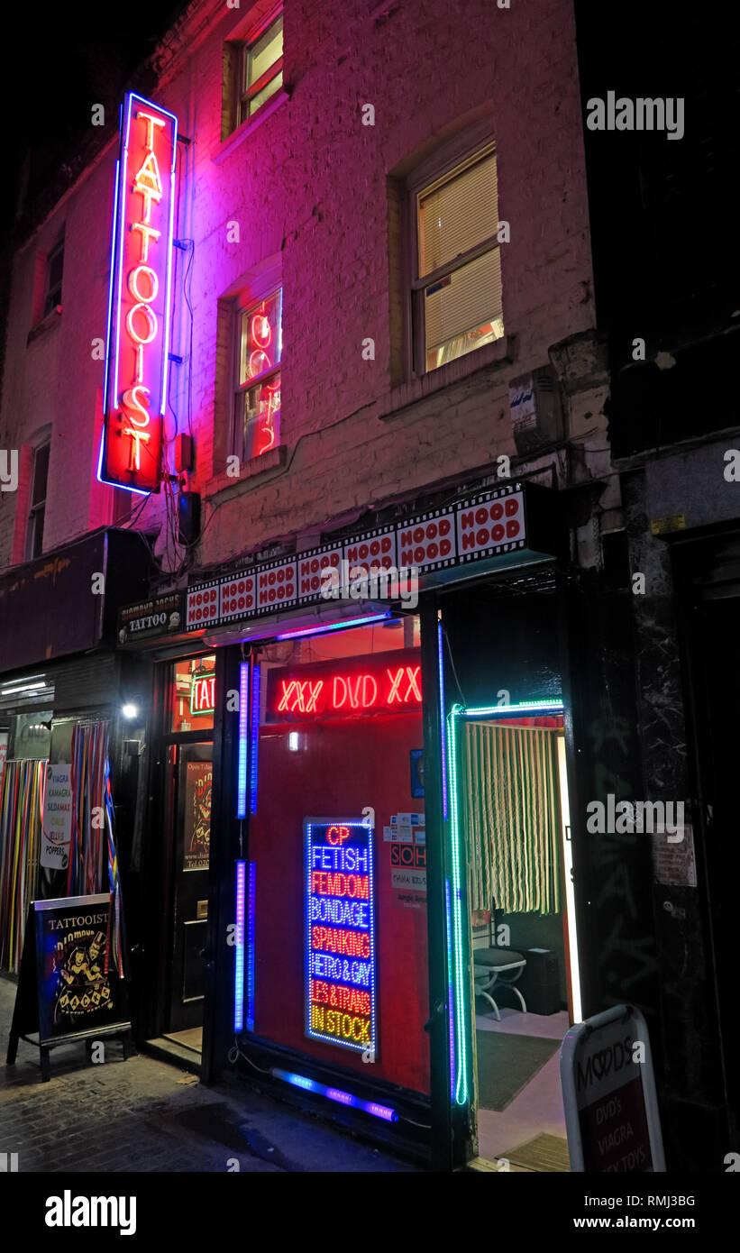 @HotpixUK,HotpixUK,GoTonySmith,England,UK,Neon,lights,night,sign,advert,bright,lighting,SoHo,South East England,City Centre,City,tourist,tourism,travel,neon sign,neon signs,evening,night time,music,shady,blue,shop,ink,skin,SoHo backstreet tattooist,SoHo back street tattooist,door,entrance,doorway,fetish,Fendom,XXX,DVD,books