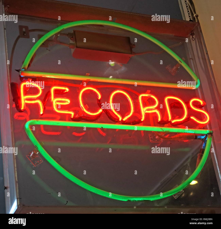 @HotpixUK,HotpixUK,GoTonySmith,England,UK,lights,night,dusk,advert,advertising,bright,lighting,South East England,City Centre,City,tourist,tourism,travel,neon sign,neon signs,evening,night time,Music legend,band member,frontman,Manchester Music Legend,Front Man,star,music,record,vinyl,green,orange,lit,circle,disk,shop window