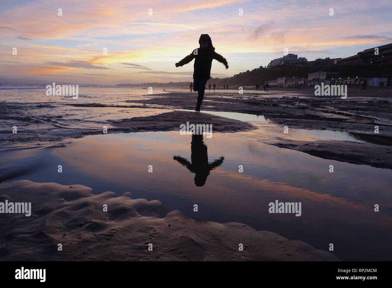Bournemouth, UK. 20th Feb, 2019: UK Weather - Bright orange sunset at the beach at Bournemouth. Matthew Ashmore/Alamy Live News Stock Photo