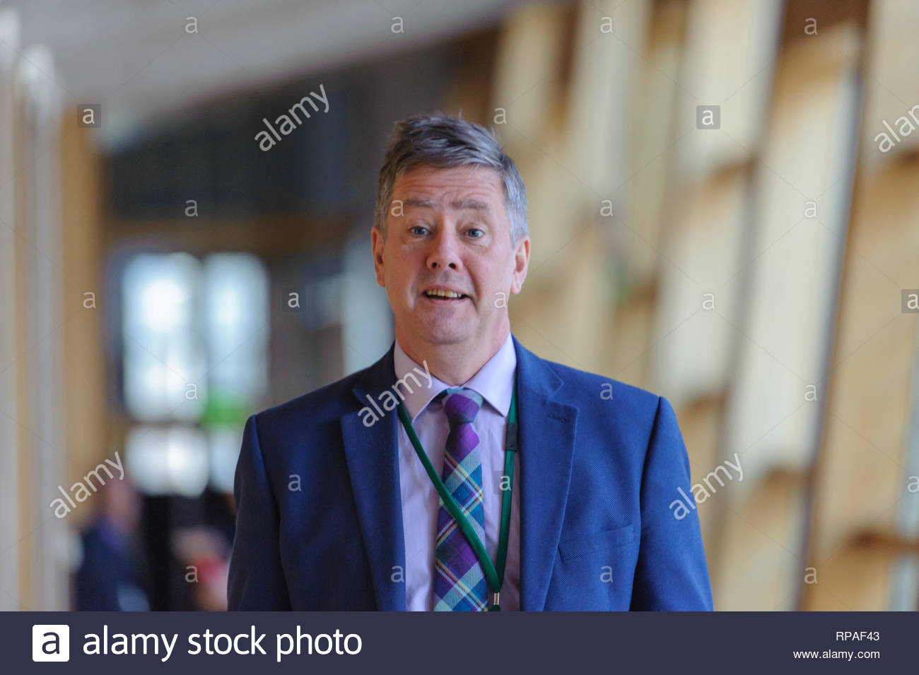 Edinburgh, UK. 21st Feb, 2019. Keith Brown MSP on his way to First Ministers Questions in the Scottish Parliament. Credit: Roger Gaisford/Alamy Live News Stock Photo