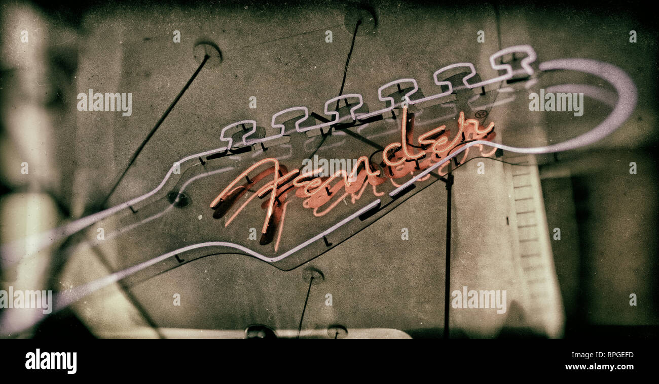 GoTonySmith,HotpixUK,@HotpixUK,Manchester,England,UK,GB,North West England,city centre,Fender,store,music,iconic,instrument,neck,guitar neck,neon,red,blue,music shop,musical instruments,muso,FMIC,Clarence Leonidas Leo Fender,guitar neon sign,Electric,acoustic,resonator,classical,Acoustic,electric bass,bass,Jazzmaster,Stratocaster,Leo Fender,Black and White,handcolored,handcoloured,distressed,book cover