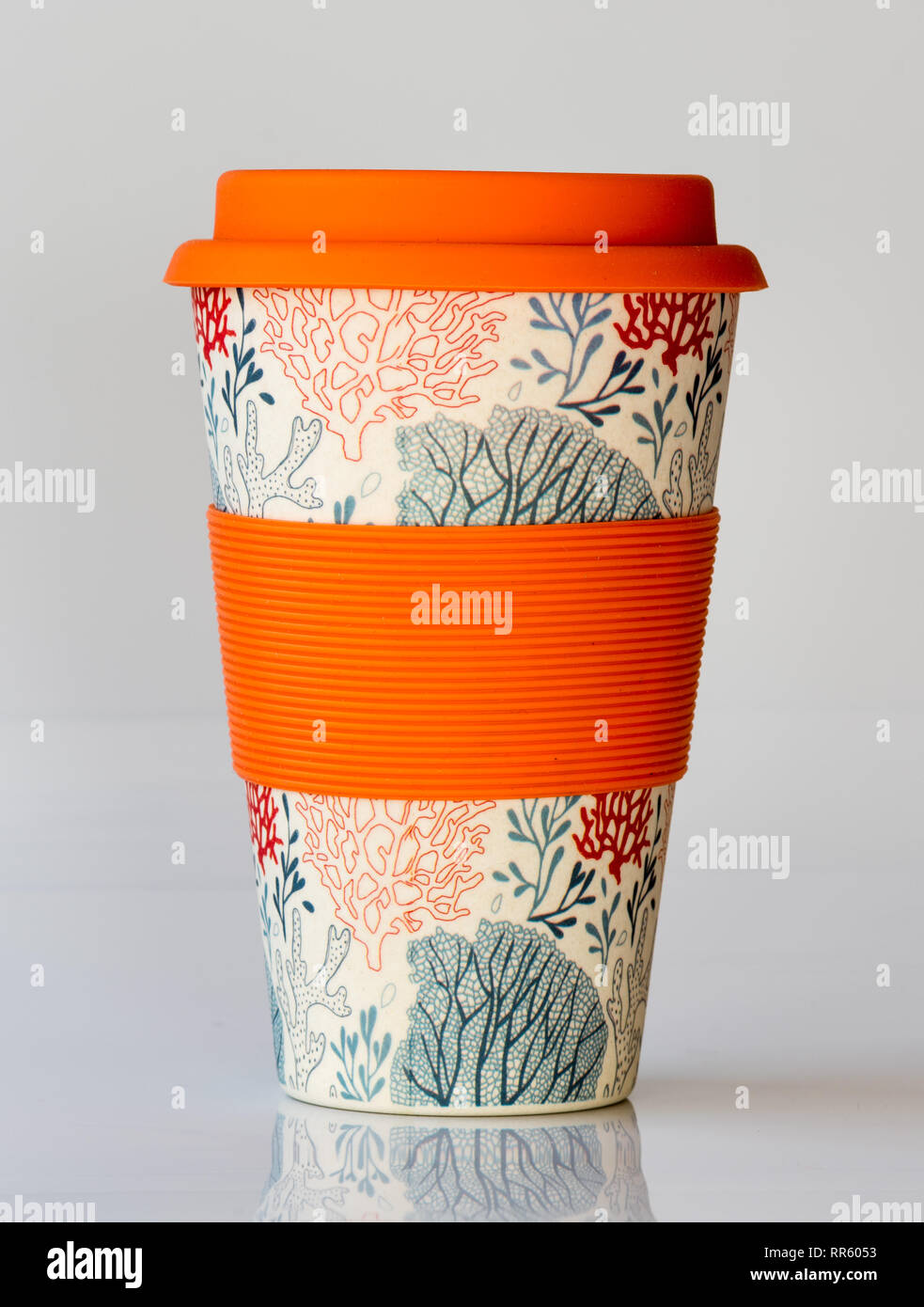 Eco-friendly biodegradable non-plastic tea/cofee travel mug with silicone sleeve and lid in great design and colour. Stock Photo