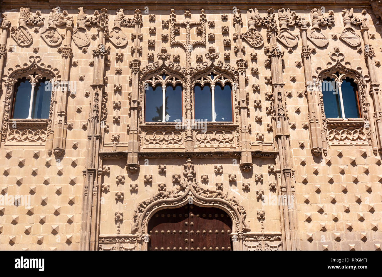 Jabalquinto Palace (Palacio de Jabalquinto), Gothic entrance flanked by two cylindrical pilasters, Baeza, Jaen province, Andalucia, Spain Stock Photo