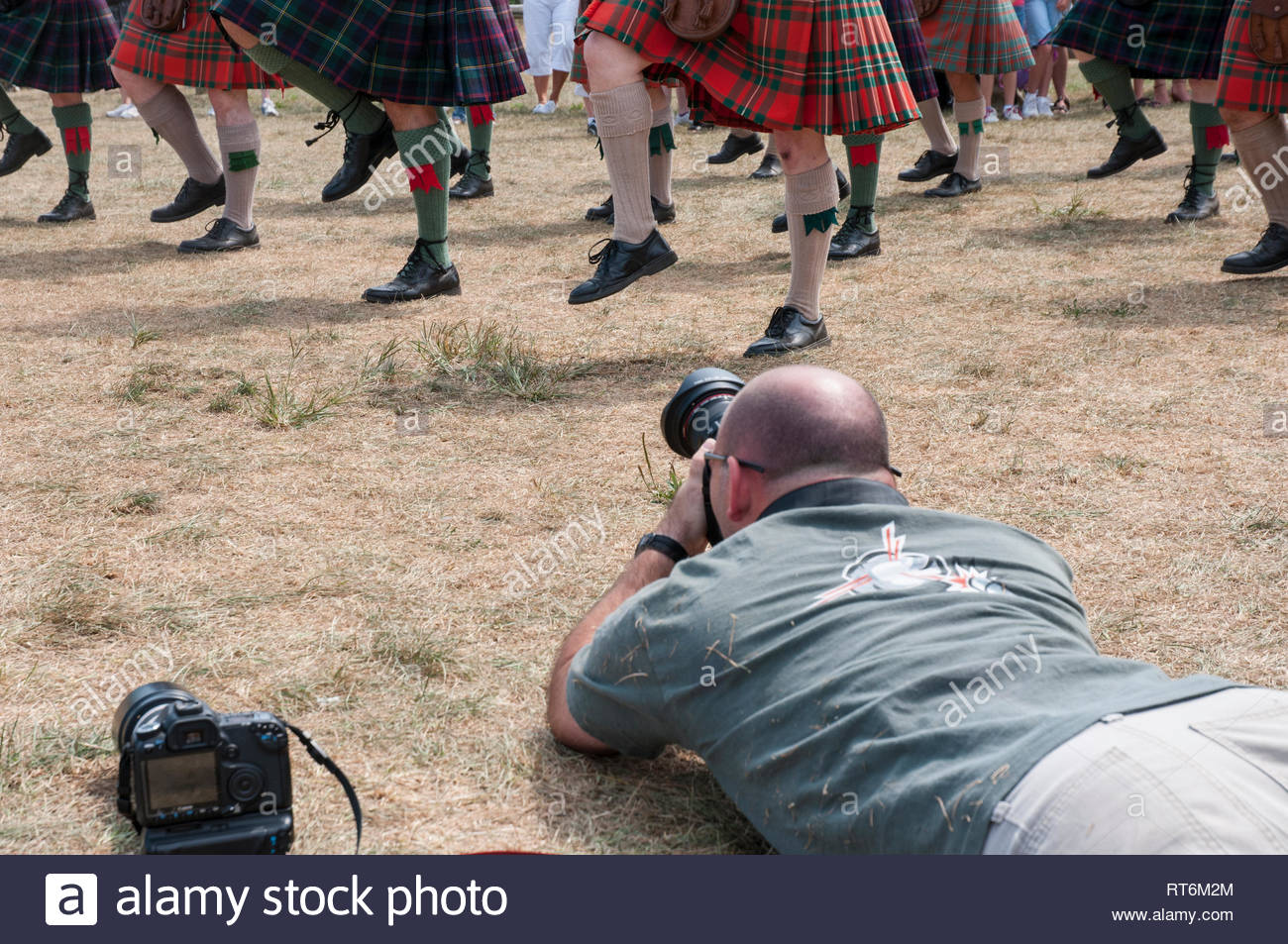 https://c7.alamy.com/comp/RT6M2M/photographer-gets-a-low-angle-shot-of-marching-bagpipers-legs-and-kilt-hems-RT6M2M.jpg