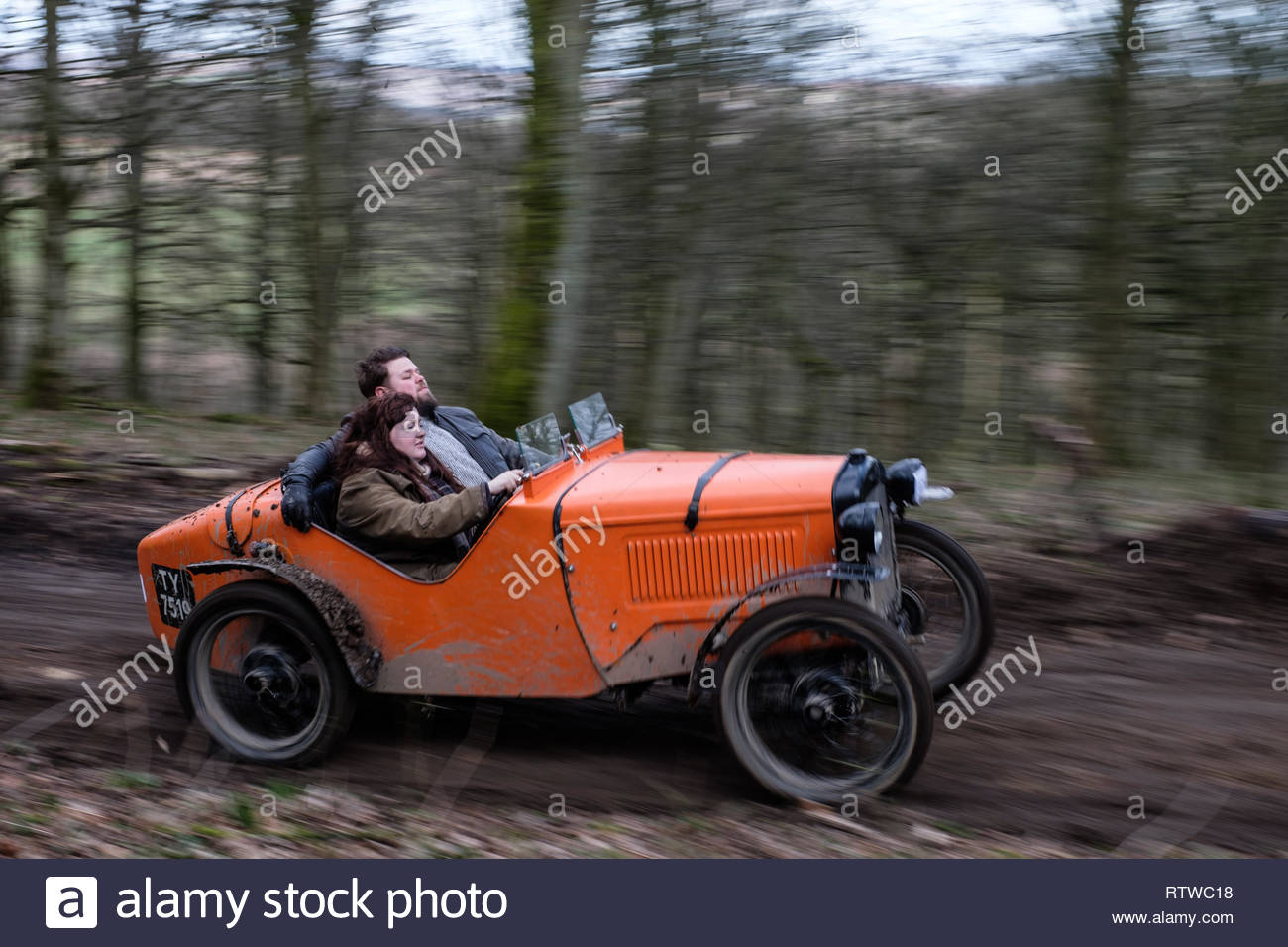 Carlton Lees, Ashover, Derbyshire, UK. 2nd March 2019. The Vintage Sports Car Club (VSCC) held its annual John Harris Trial for vintage pre-war cars in the Derbyshire countryside around Ashover village. One of challenges faced by competitors was on hills at Carlton Lees. In a VSCC Trial competitors score points depending how far they travel up the hill. Competitors must carry passengers who are called 'Bouncers'. Bouncing gives the car more grip and helps it to travel further up the hill. © Gary Clarke/Alamy Live News Stock Photo