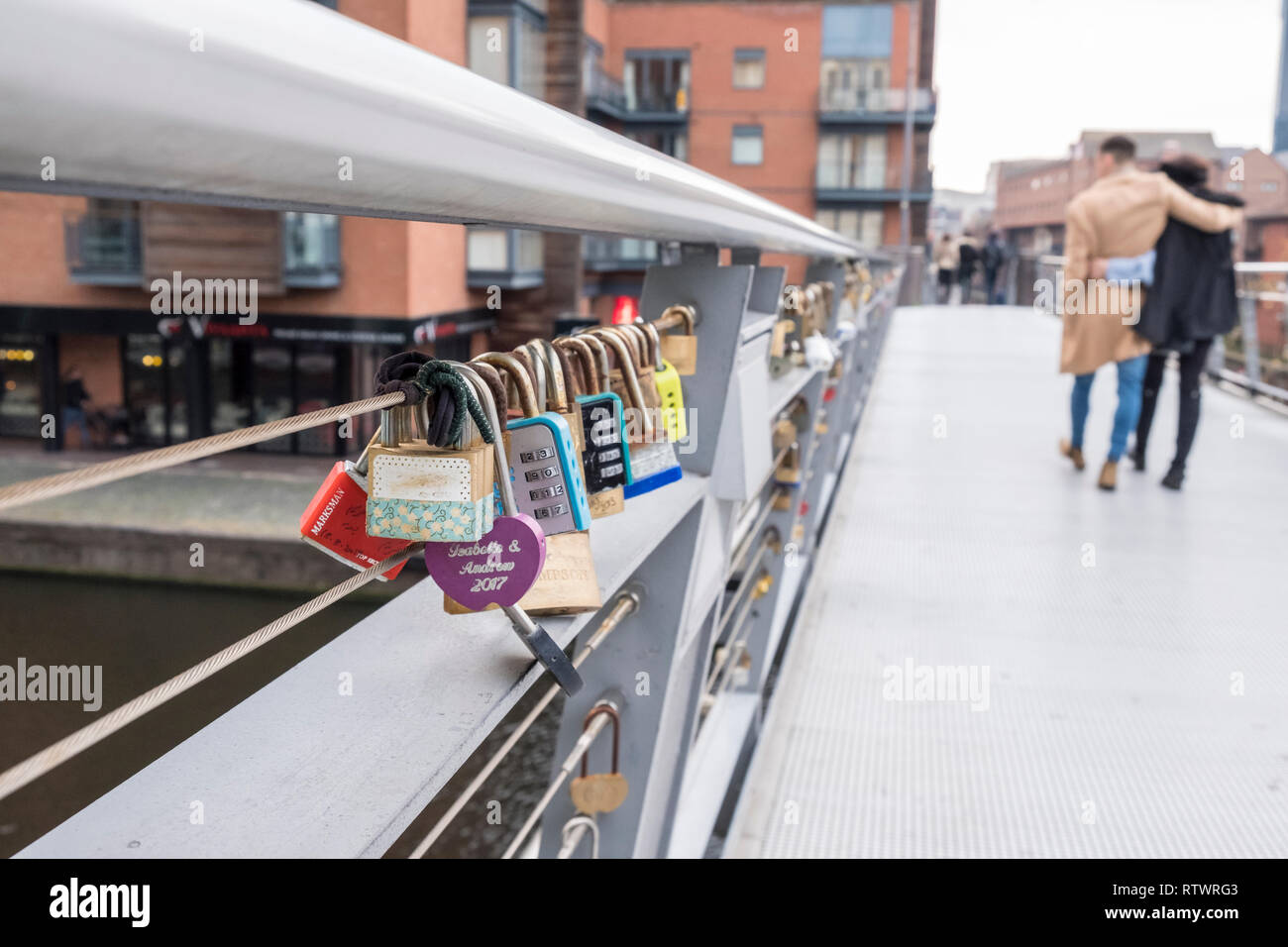 embracing-couple-walk-past-lovelocks-or-