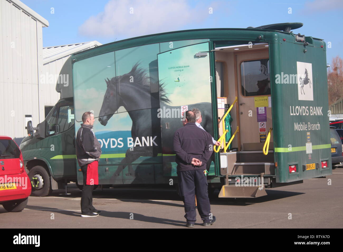 A MOBILE BANK OF LLOYDS BANK IN USE Stock Photo