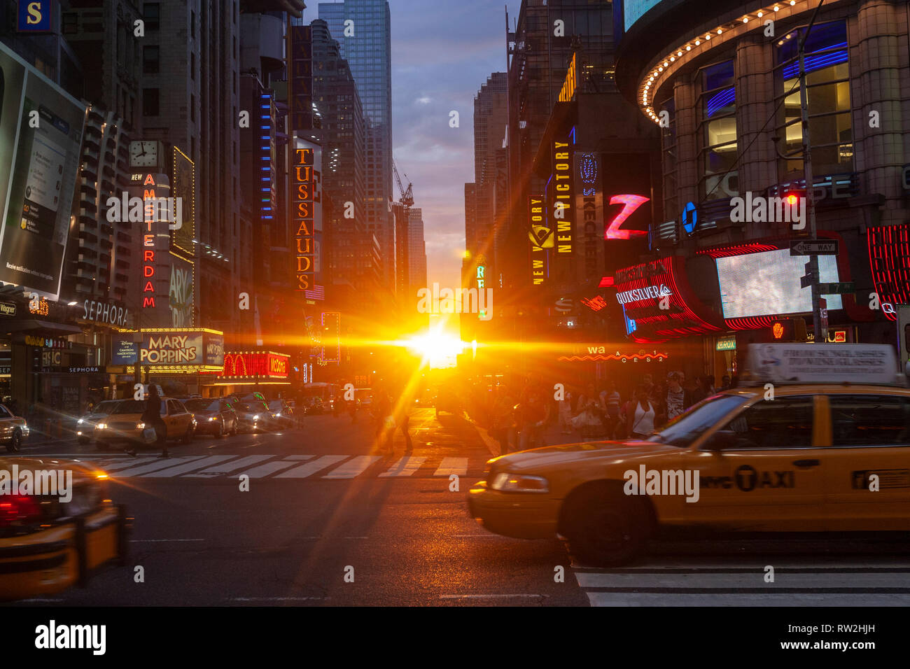 Yellow taxis in W 42nd St at sunset near Times Sq, Manhattan, New York City, USA Stock Photo