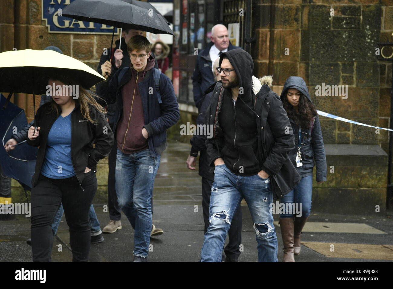 Glasgow, Glasgow City, UK. 6th Mar, 2019. Students are seen departing from the area.Police have found a suspicious package at Glasgow University in Scotland. Police and Campus Staff have shut the area down for the time being. Credit: Stewart Kirby/SOPA Images/ZUMA Wire/Alamy Live News Stock Photo