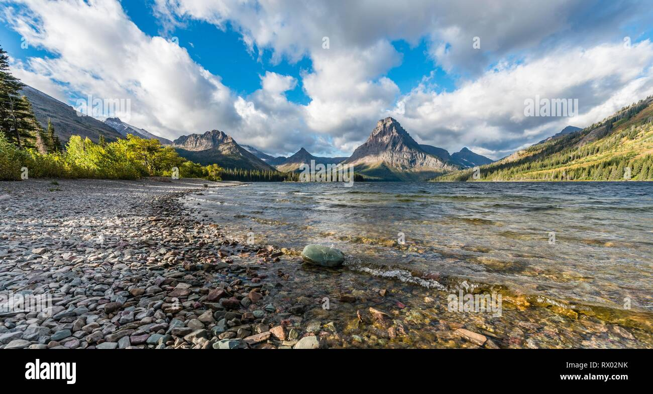 Mountain lake Two Medicine Lake in mountain landscape, back Sinopah Mountain, Glacier National Park, Montana, USA Stock Photo