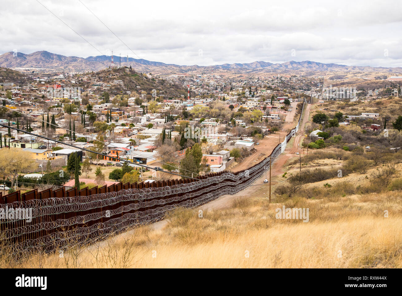 US-Mexico international border: Layers of Concertina are added to existing barrier infrastructure along the U.S. - Mexico border near Nogales, AZ, on February 4, 2019. See more information below. Stock Photo