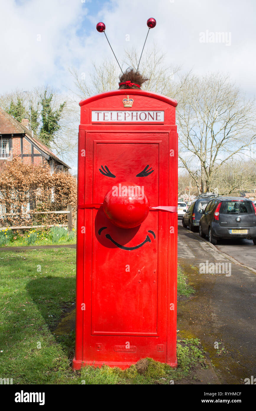 compton-surrey-uk-14th-march-2019-the-phone-box-in-compton-village-has-been-decorated-in-support-of-red-nose-day-which-takes-place-on-friday-15th-march-by-local-resident-and-parish-councillor-mr-chris-sharples-a-painted-disposable-beer-keg-was-used-for-the-red-nose-credit-gillian-pullingeralamy-live-news-RYHMCF.jpg