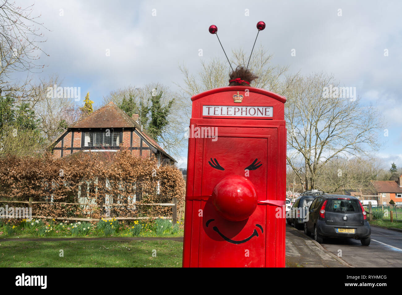 compton-surrey-uk-14th-march-2019-the-phone-box-in-compton-village-has-been-decorated-in-support-of-red-nose-day-which-takes-place-on-friday-15th-march-by-local-resident-and-parish-councillor-mr-chris-sharples-a-painted-disposable-beer-keg-was-used-for-the-red-nose-credit-gillian-pullingeralamy-live-news-RYHMCG.jpg