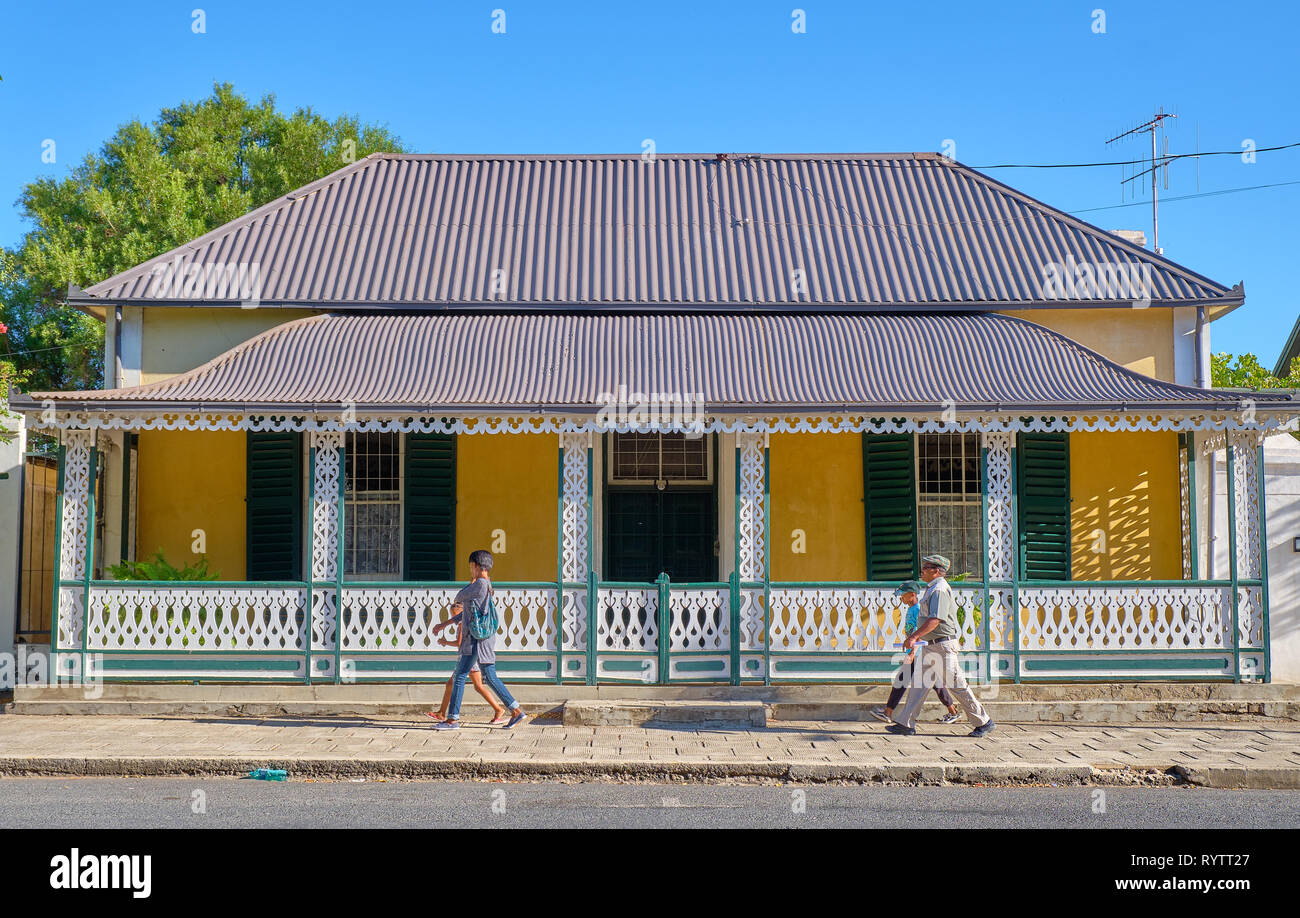 Local pedestrians walking in front of typical Karoo victorian architecture, in Graaff Reinet, South Africa Stock Photo