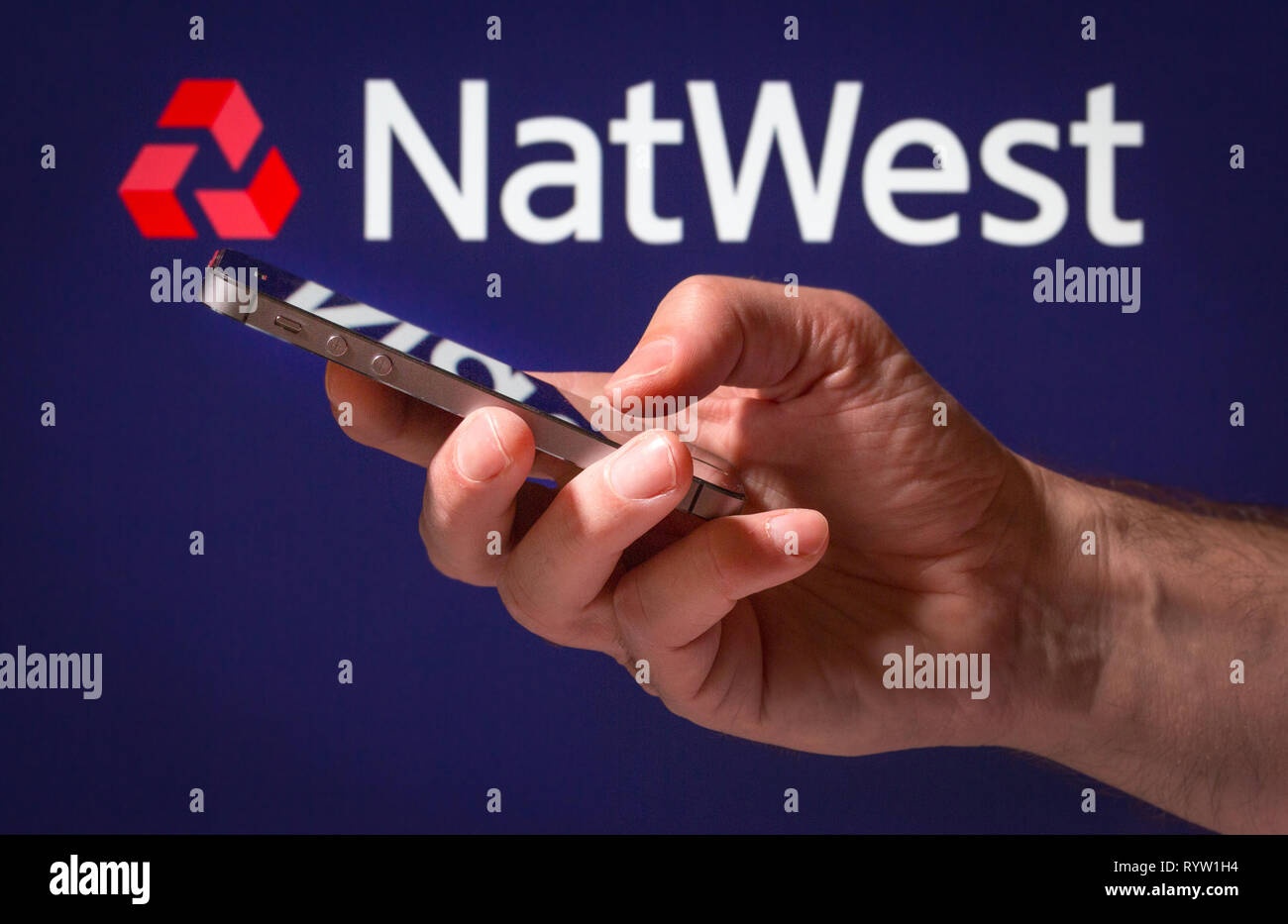 A man using Natwest online banking on his mobile phone Stock Photo