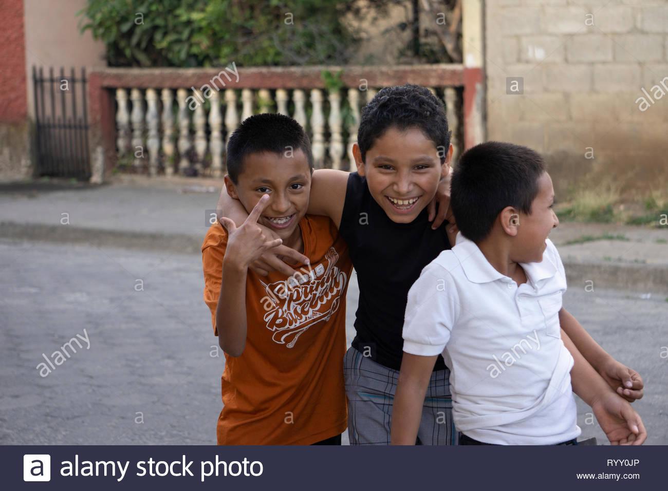 Three children in Jinotega, Nicaragua, goof for the camera. Stock Photo
